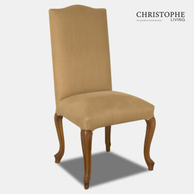 Timber chair with light timber finish and medium colour linen upholstered back with curves legs and top in French style.