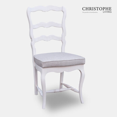 French country chair or farmhouse style dining chair painted white with ladder back carved design and light grey upholstered cushion seat