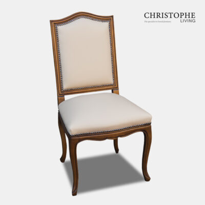 French chair for dining room with timber frame and leather upholstery and Hamptons style studding in walnut finish with curved apron