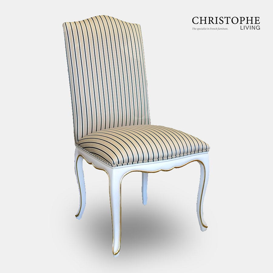 French fully upholstered dining chair with stripe fabric in white with gold painted on carving of apron and legs.