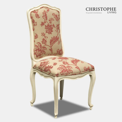 French Chateaux style dining chair in cream finish with red and cream floral damask fabric and double piping on upholstery.