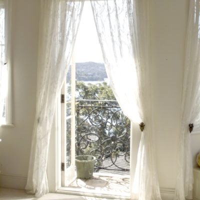 French Style Home Bedroom Window with White Curtains & Gold Pelmet