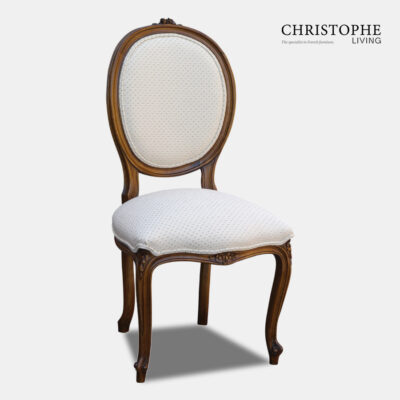 Timber French provincial dining chair with oval back and carved motif with linen upholstery and Louis XV style