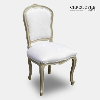 Classic looking shield back dining chair with a painted finish and upholstered in white linen
