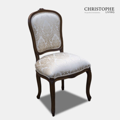 French Louis reproduction antique style dining chair upholstered in cream damask and in timber finish.