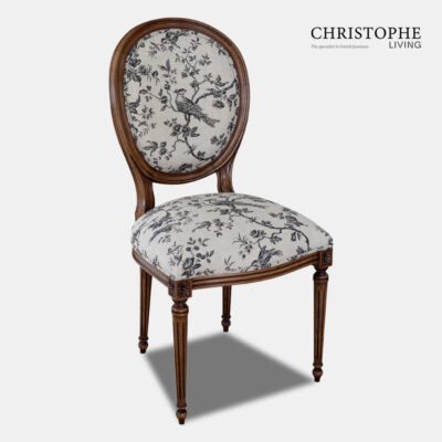 Louis XVI oval back dining chair with upholstery in grey bird toile French fabric and finish in walnut timber