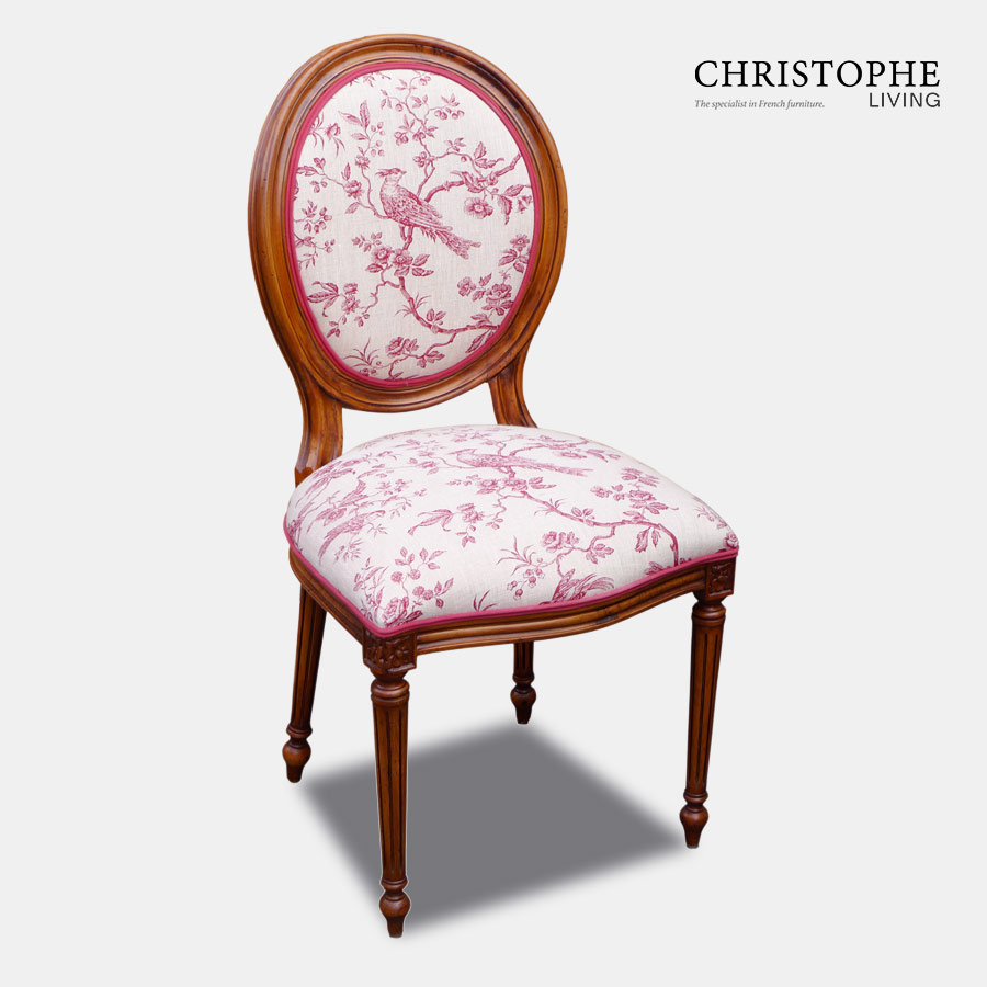 Louis oval back dining chair in timber with red and cream bird toile linen and a double row of red contrast piping.