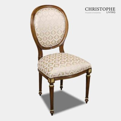 Classic looking chair in French Louis style with cream damask and gold on chair legs carving