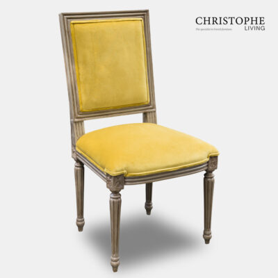 Louis XVI reproduction square back dining chair in special antique finish with yellow velvet and piping.