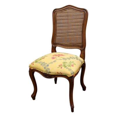 French classic Provence style dining chair with yellow brocade fabric and cane back in timber with carving