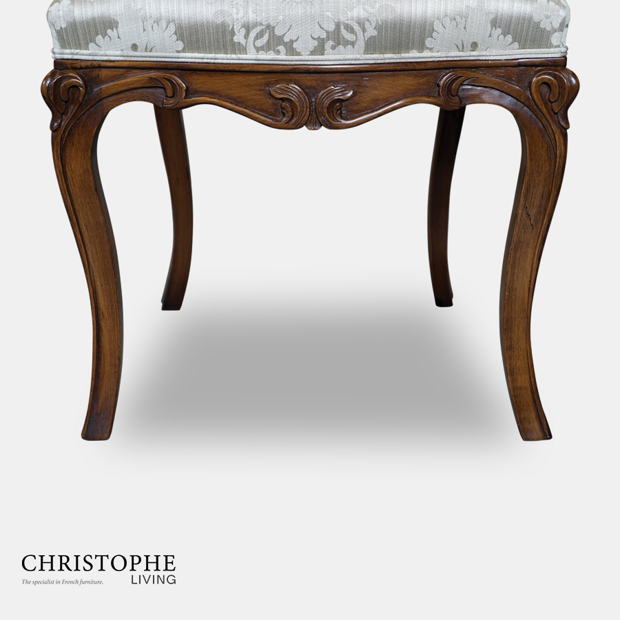 Luxurious French style dining chair fully upholstered in French blue damask with dark timber legs and ornate carvings