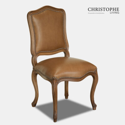 Timber chair in French Louis style with curved carvings and brown leather sith studding in classic look.