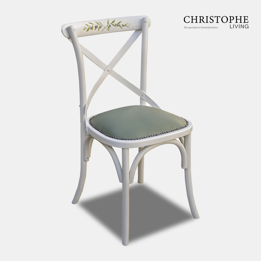 French provincial cross back white dining chair hand painted with olive leaf motif and leather seat with Hamptons style studs.