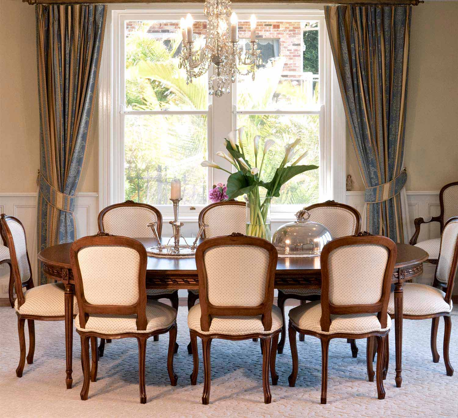 4 French dining with timber Louis XVI table and Louis XV chairs and a classical chandelier