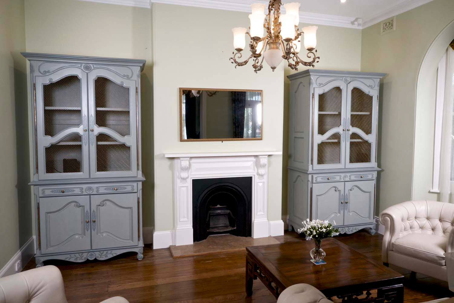 4 Lounge room with custom built buffets in french style with chandelier and coffee table