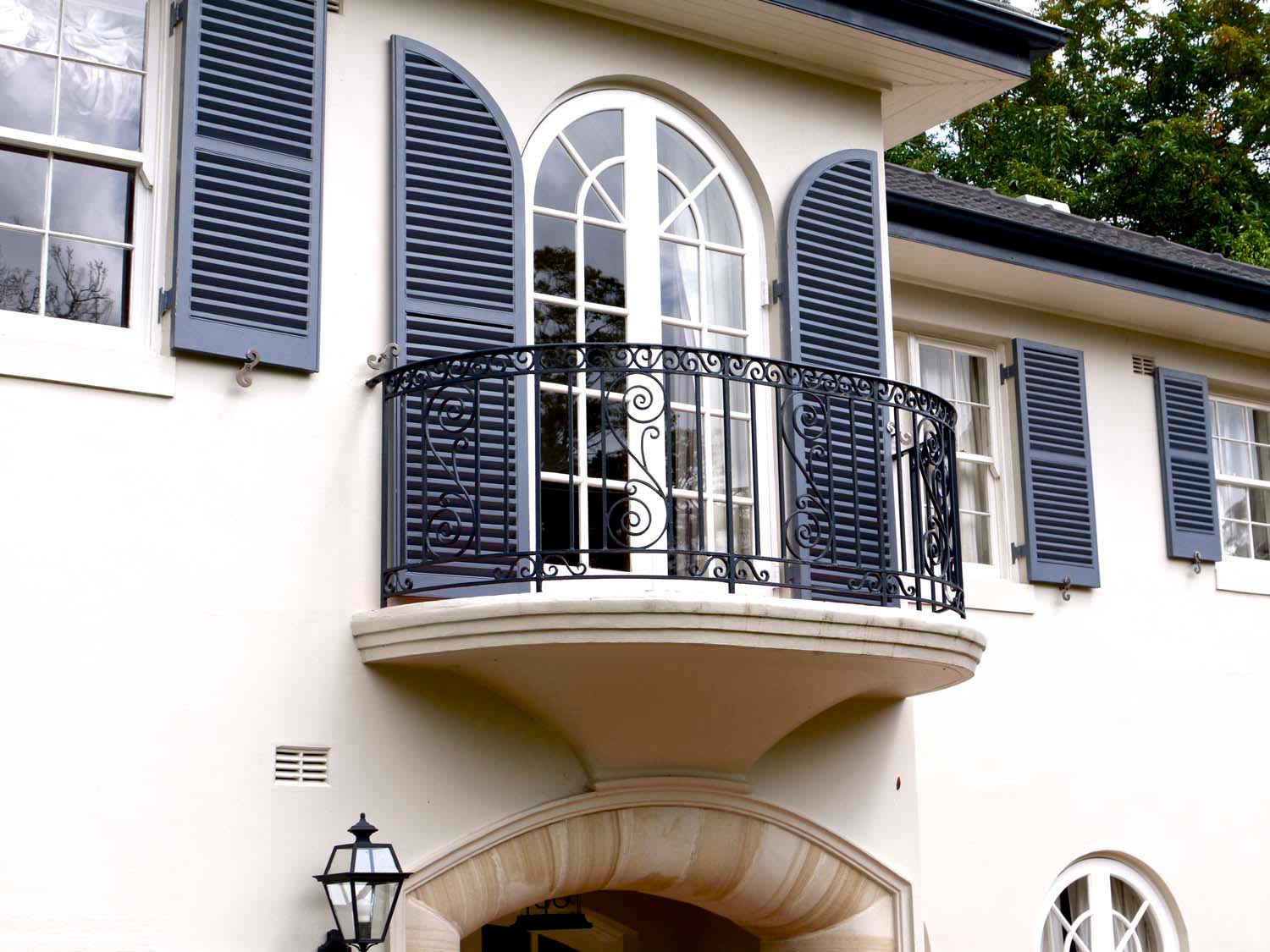 8 French doors on french home with outdoor lantern and custom design features