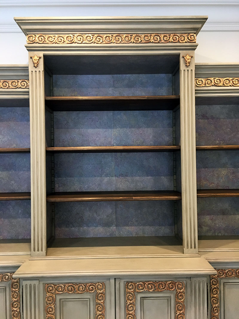 Gold leaf finished bookcase