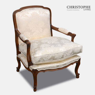 Quality carved walnut timber French armchair with loose cushion, cream damask fabric and curved legs for the loungeroom.