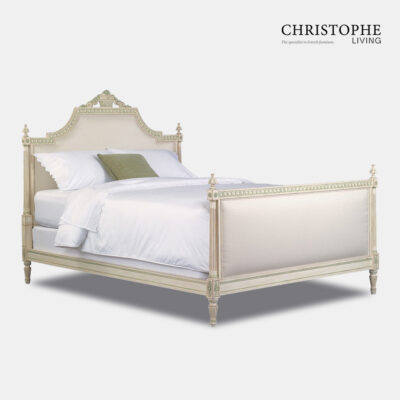 French bed in Louis style with ornate carving on bedhead in antique white finish with painted blue highlights