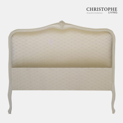 French style bedhead in antique white with carving at top and curved legs in diamond fabric