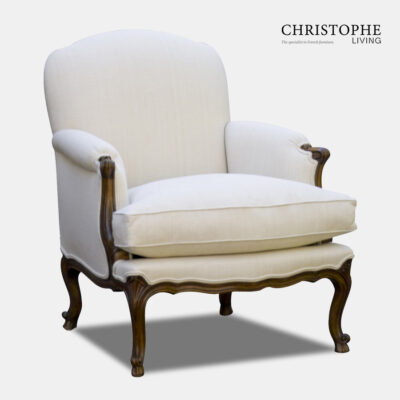 French provincial style armchair for loungeroom fully upholstered in linen with cabriole legs and carving on timber.
