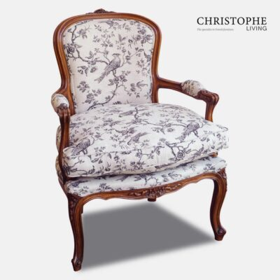 French country style white painted bedroom armchair fully upholstered in linen bird fabric with a timber finish and carved in Italy.