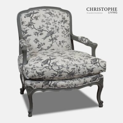 Grey painted armchair in French style with bird toile linen fabric. Chair has carved cabriole legs and is made from European beech timber.