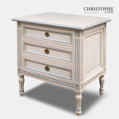 French bedside table with antique white painted finish and blue on carving with Louis XVI style legs and antique patina.