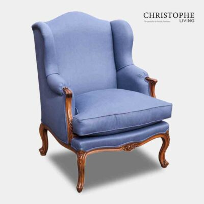 Wing chair in French style fully upholstered in a medium blue fabric with timber walnut frame.