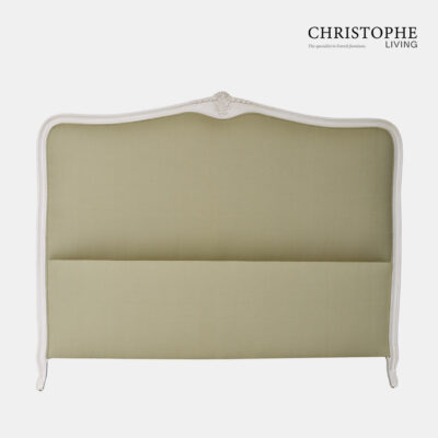 White painted French style bedhead upholstered with green linen fabric with cabriole legs and carving top