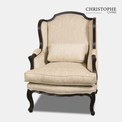 Classic antique style armchair painted in black with golden stripe fabric and matching pillow with upholstered armrests.