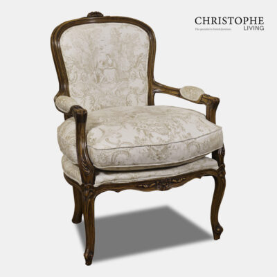 French timber lounge chair with beige and white linen French fabric. Louis furniture style with carved legs and arms rests.