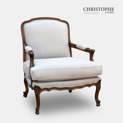 French country armchair upholstered in light linen fabric with a timber finish and hand done carving in Italy.